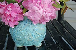 Blue bird and flower vase
