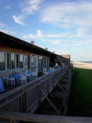 J&r beach club deck blue linens white chiavaris